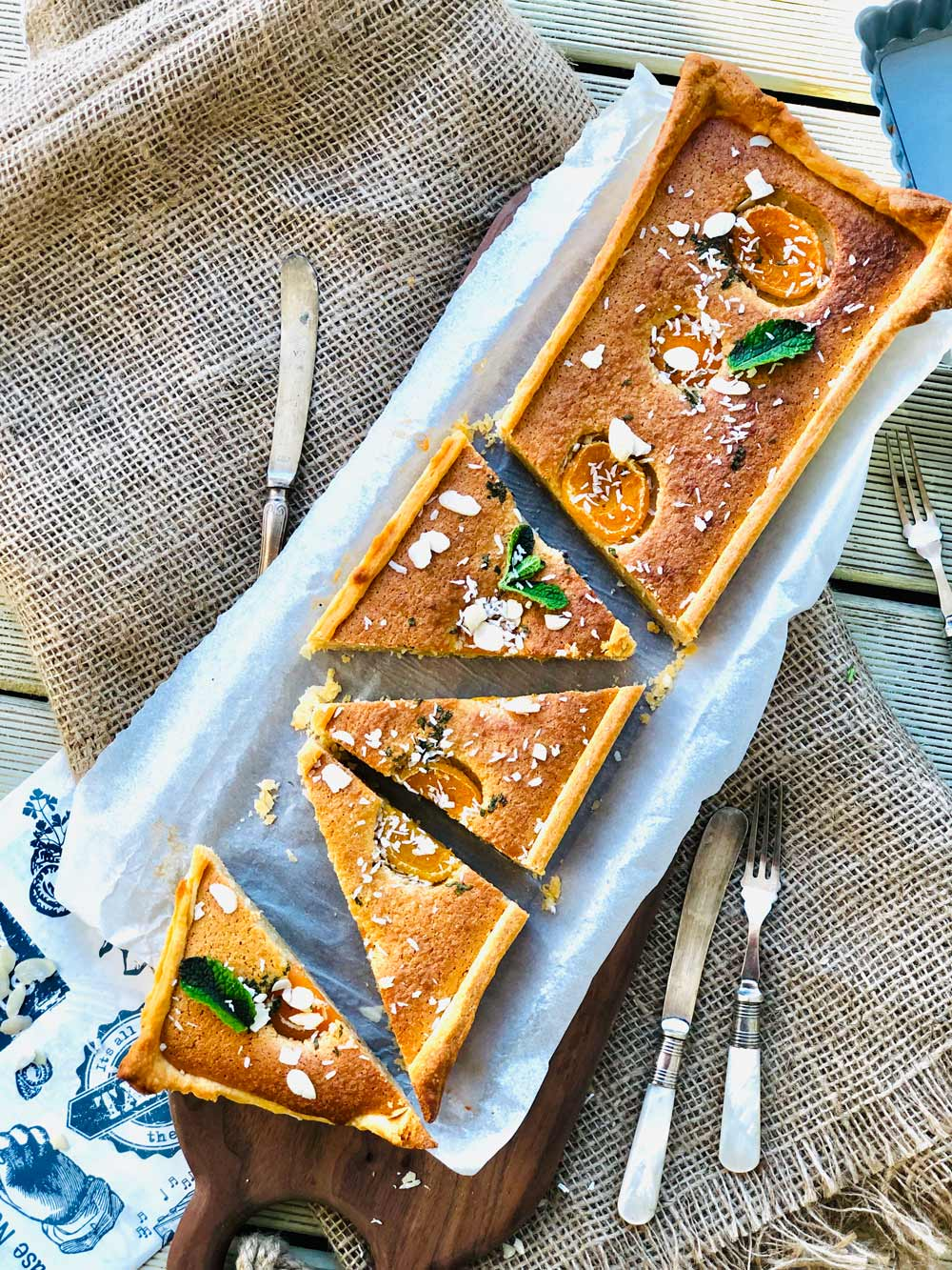Almond flour cake with apricots, coconut and mint
