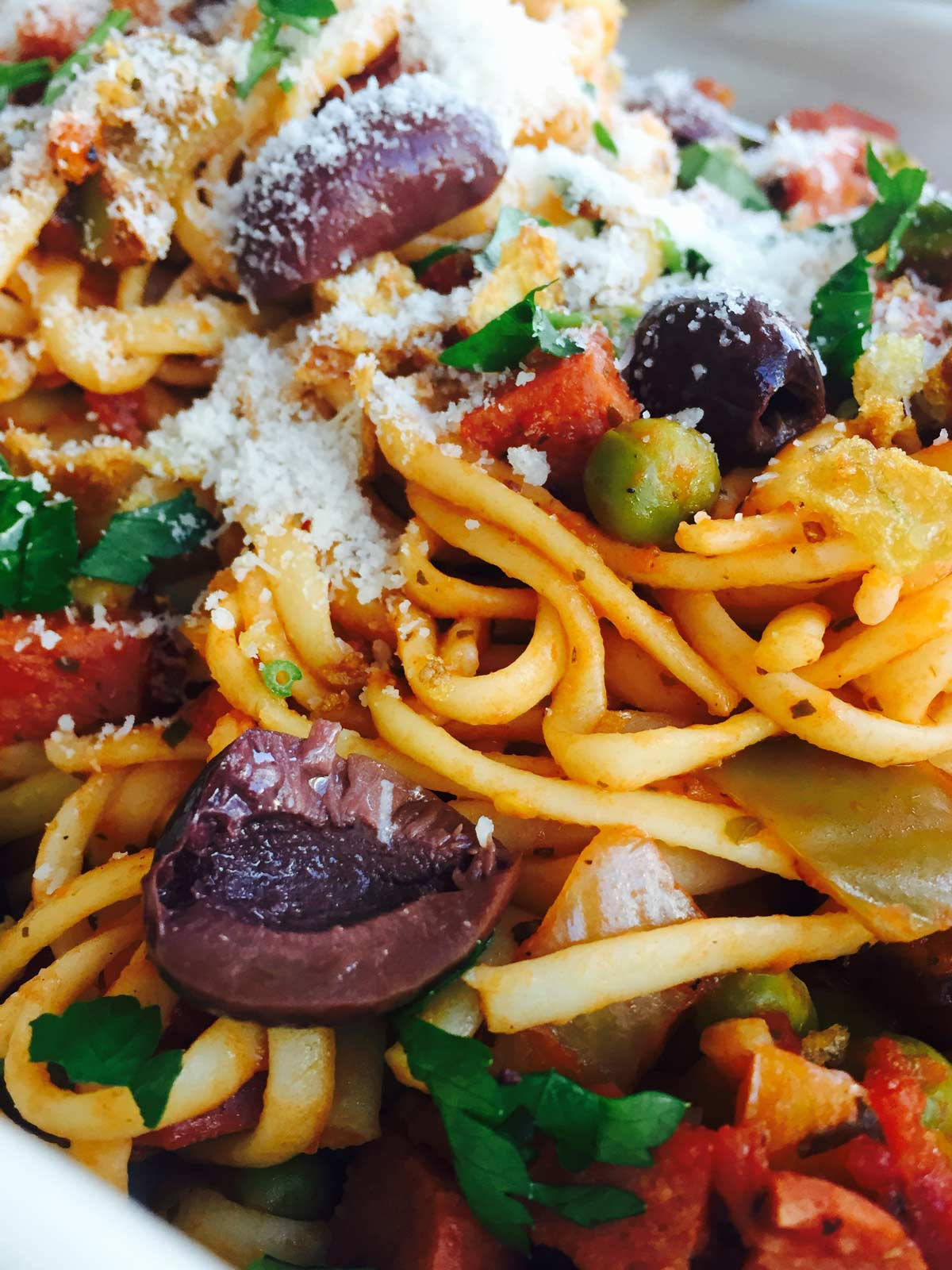 Delicious Chunky Beef Frankfurters, vegetables and kalamata olives linguini