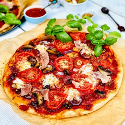 Healthy homemade pizza on brown parchment paper