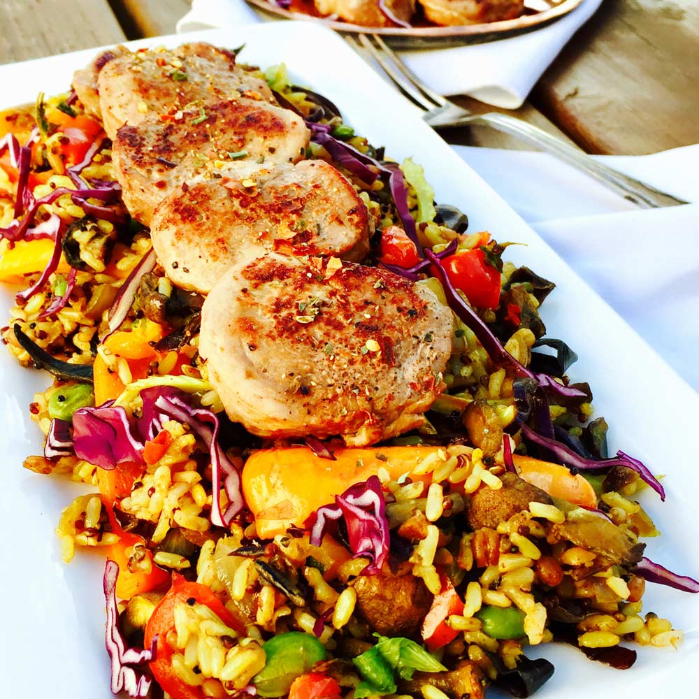 Pork medallions with seasonal vegetables