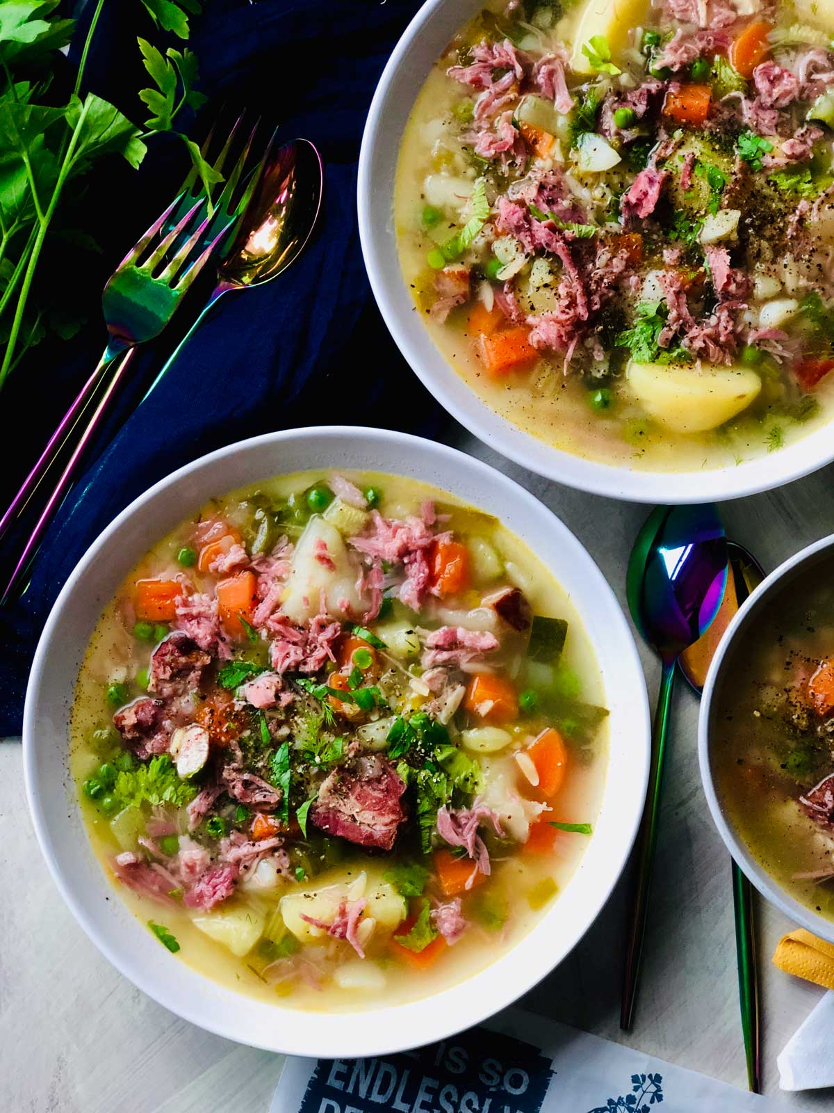 Potato soup with ham hock and petit pois
