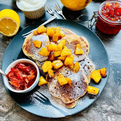 Ricotta pancakes with pineapple and rum