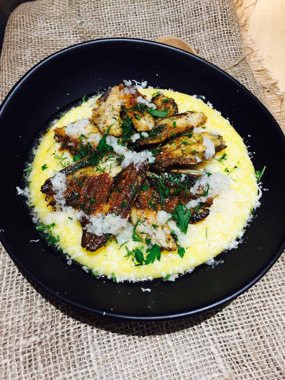 sardine and polenta with garlic and Parmesan cheese