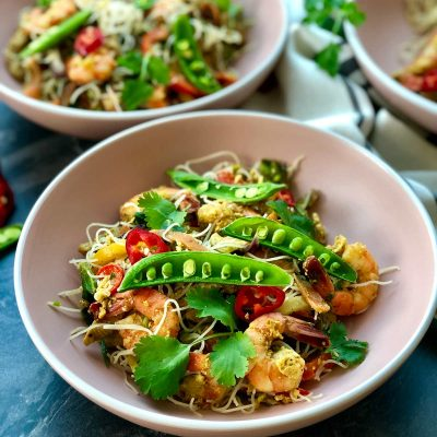 Singapore-style noodles stir fried with shrimps and vegetables