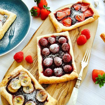Homemade tutti-fruity jam and fresh fruit tartlets