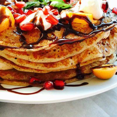 Tutti-frutti fluffy pancake cake with fruits and creme boolla-boolla