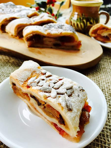 A close-up of an apple strudel roulade.