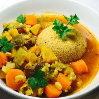 Couscous & lamb casserole, in a white bowl