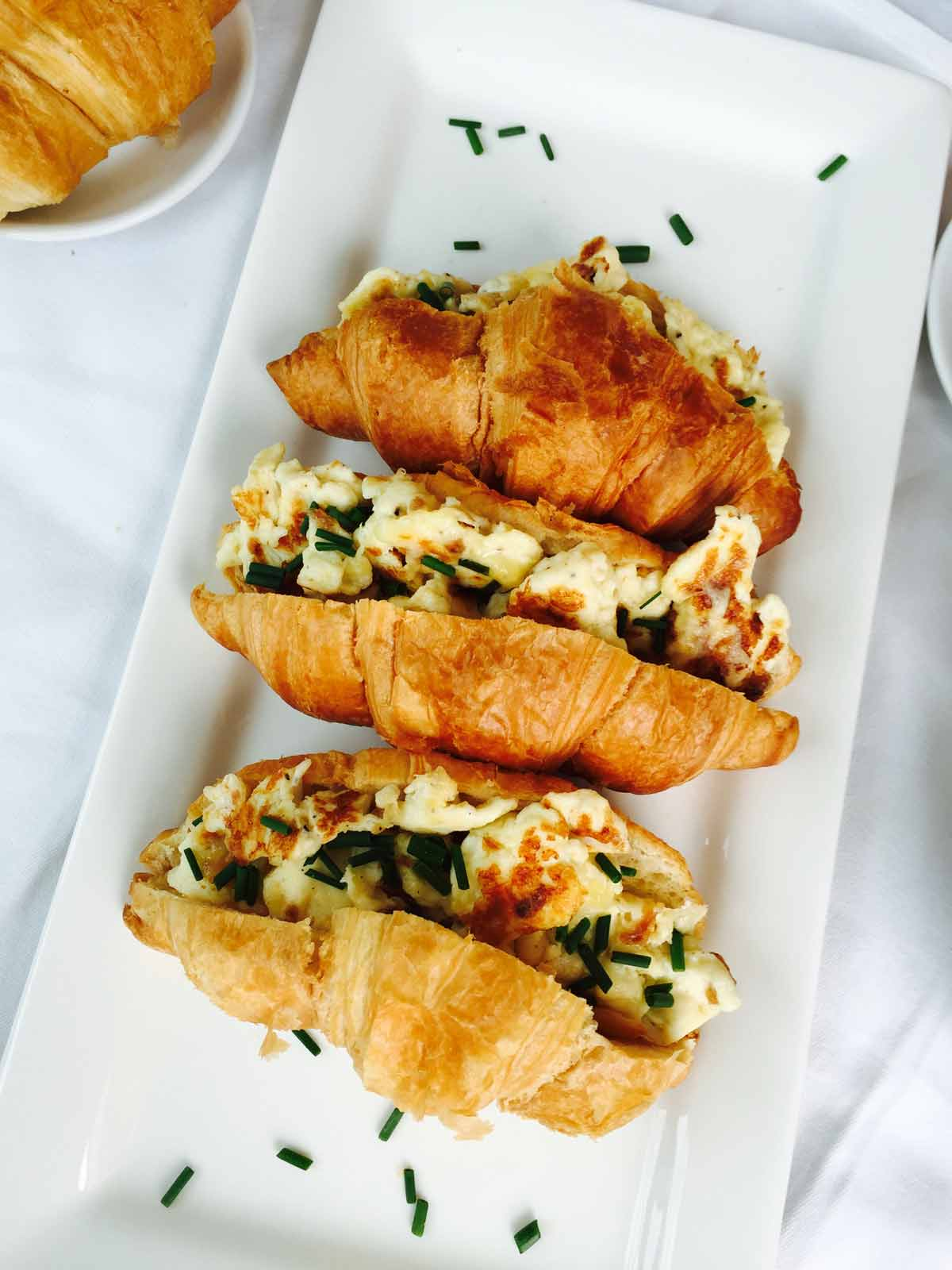 This morning croissant and scrambled eggs treat is a tasty and truly delightful way to start your day!