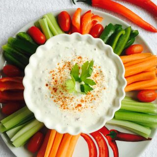 Cucumber, fennel and yoghurt dip, in a white bowl