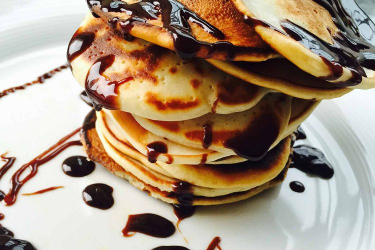 Everyday basic pancakes, stacked, with syroup