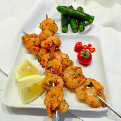 Succulent exotic BBQ-ed prawns