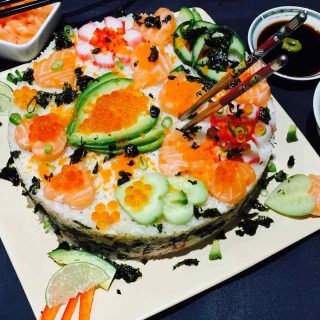 A delightful plate of homemade sushi cake.