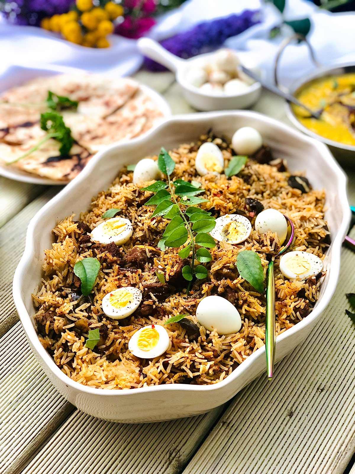 Superb Lamb Biryani with Quail Eggs in a White Dish