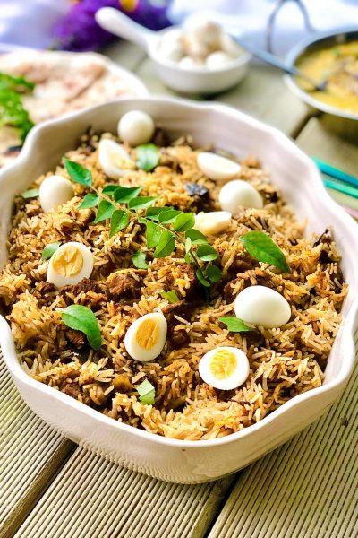 Lamb Biryani with Quail Eggs in a White dish