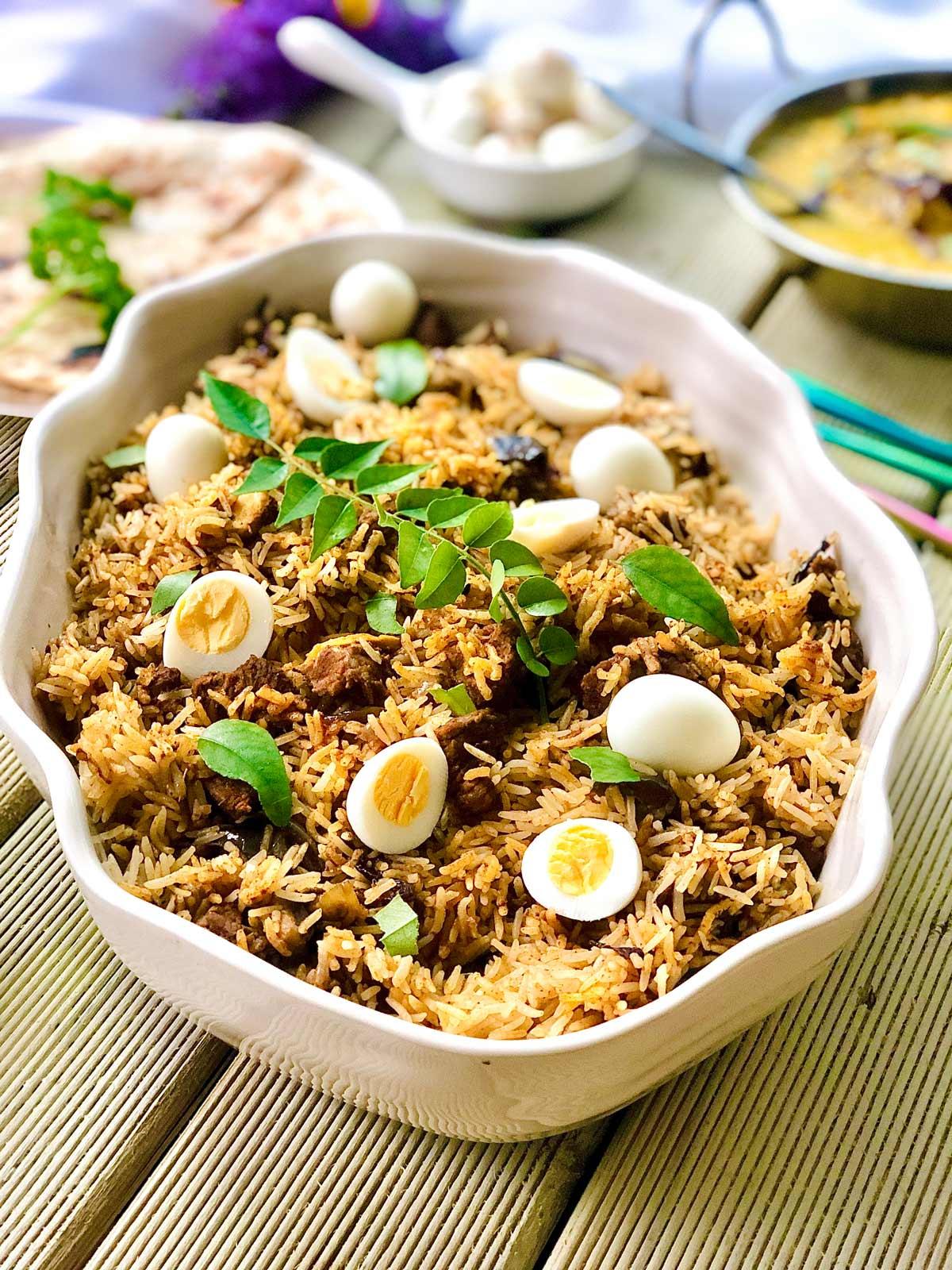 Lamb Biryani with Quail Eggs in a White Pot