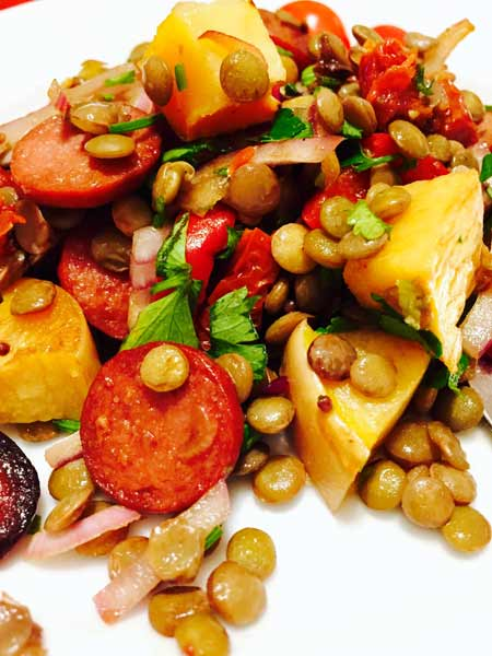 A close-up of the lentils, chorizo and tomatoes meal, all ready to taste.