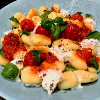 Serve potato gnocchi with buffalo mozzarella and whole cherry tomatoes and basil sauce, an absolutely yummy pasta dish.