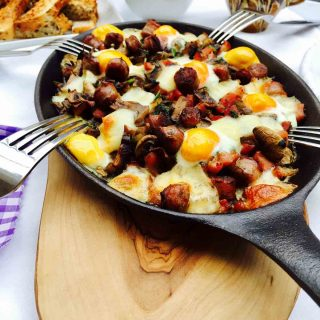 Breakfast: a skillet filled with quail eggs, mushrooms and bacon.