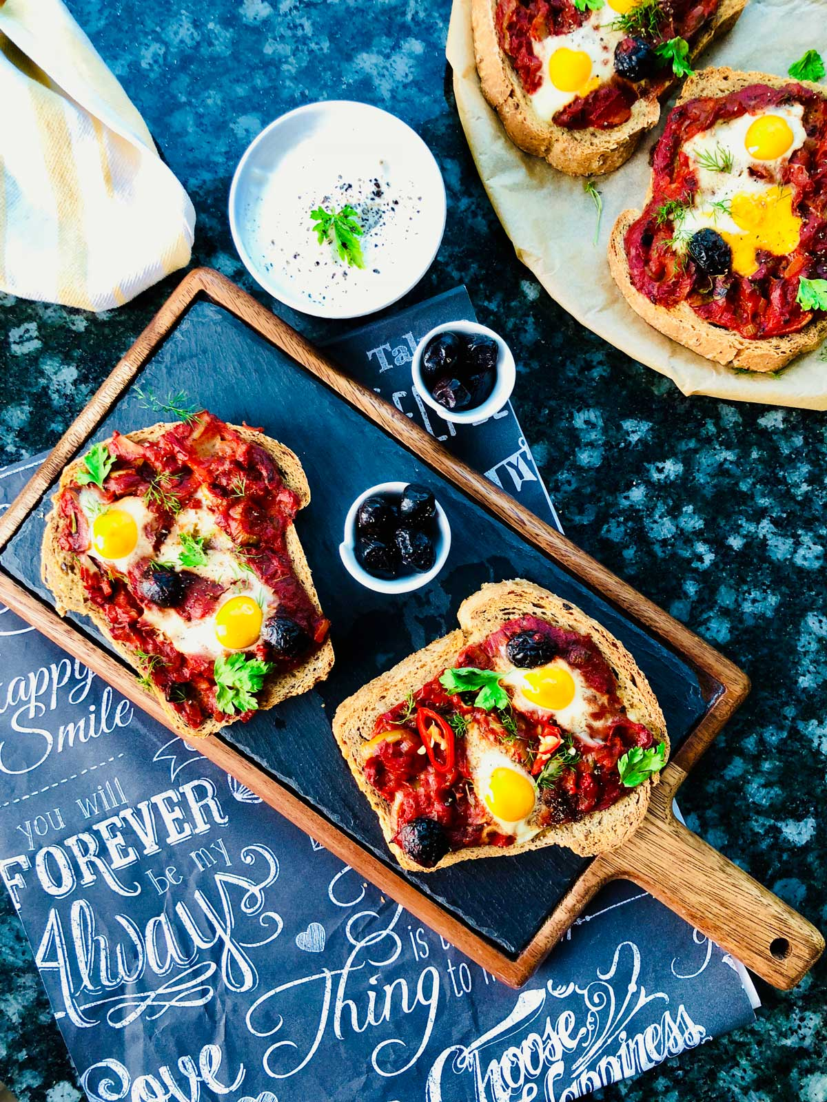 Pizza slices with quail eggs and tomato sauce