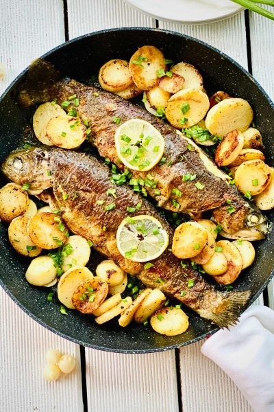 Delicious Rainbow Trout With Potatoes And Garlic
