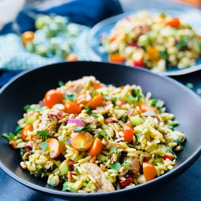 Shredded roast chicken with pesto, crudités bits and orzo summer salad