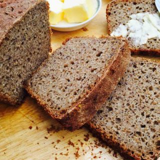 Enjoy a slice of sourdough rye bread, a tasty home-kneaded bread recipe with spelt flour and other organic ingredients.