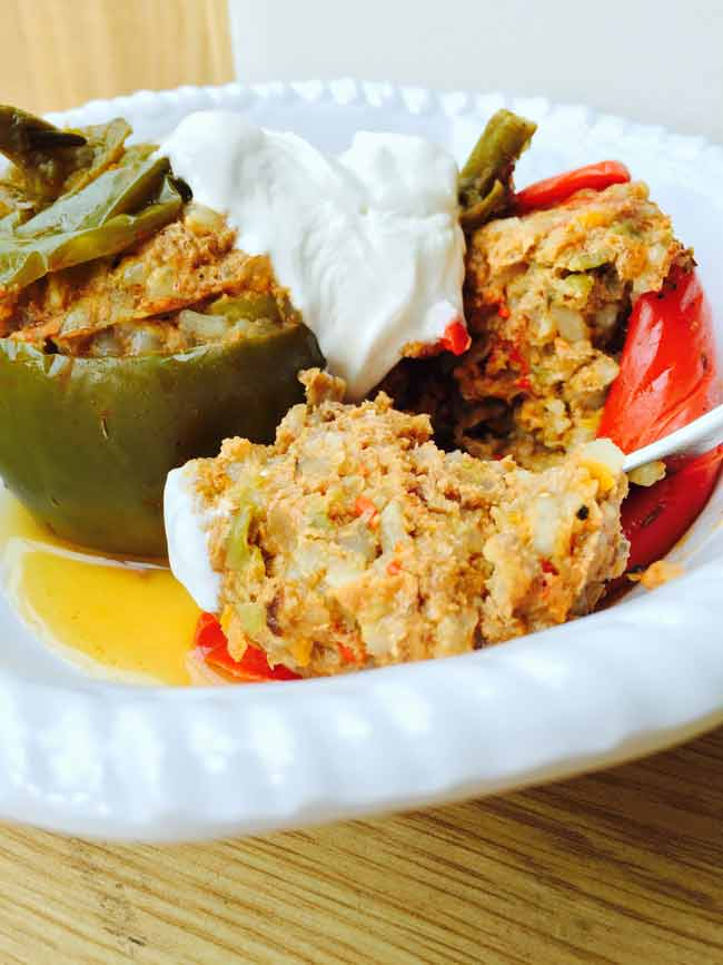 A split stuffed pepper with cream topping, delicious!