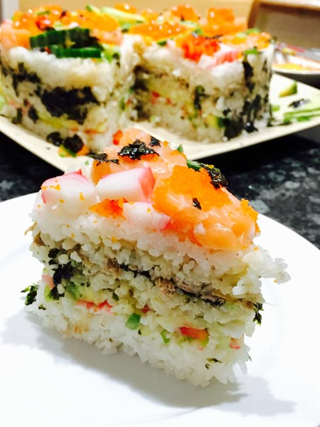 A delicious slice of homemade sushi cake.