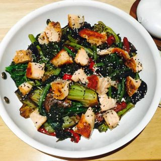 Tatsoi, hoisin & salmon stir fry, in a white pan