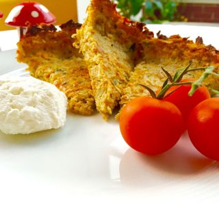 Vegetable flan slices on a white plate