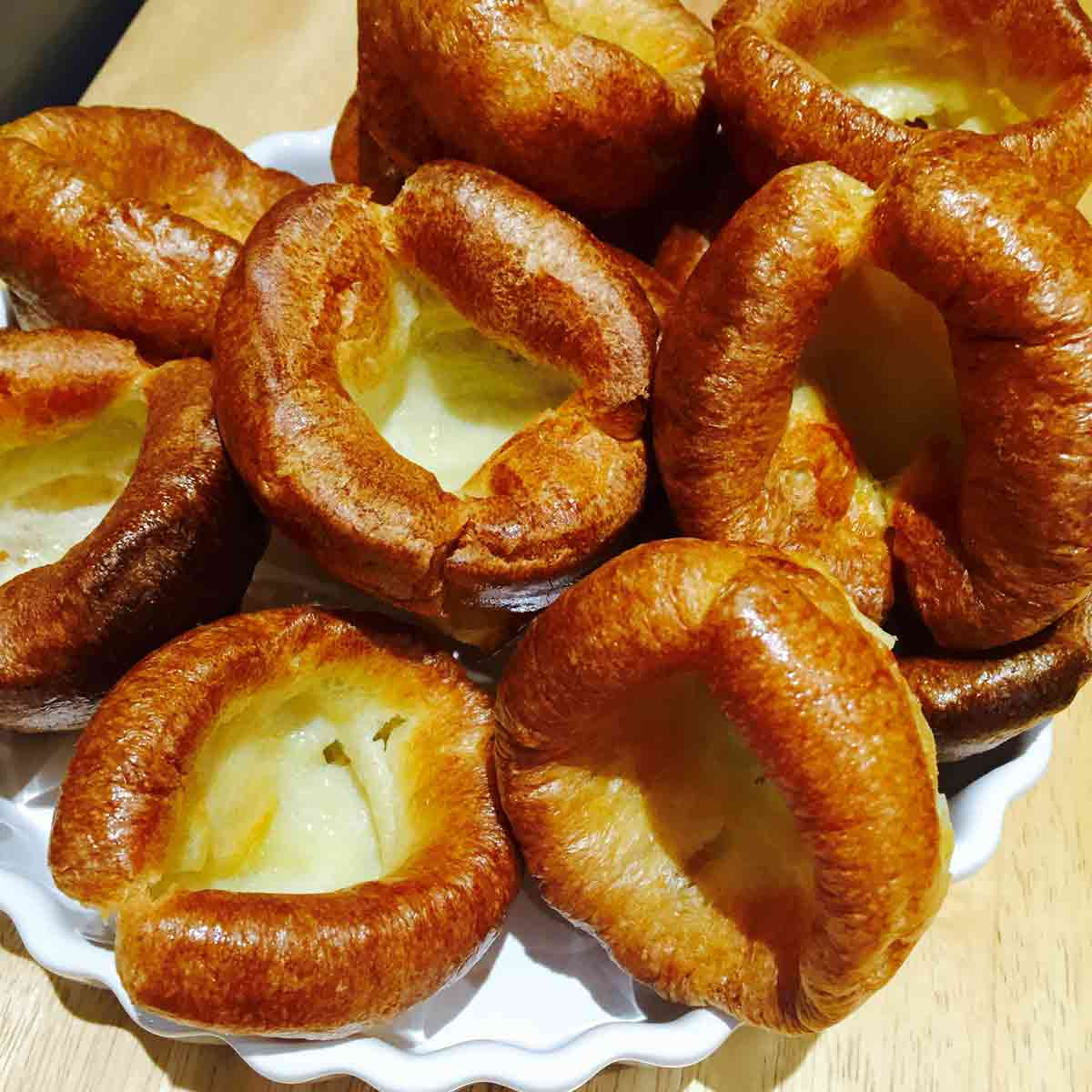Yorkshire puddings on a white plate